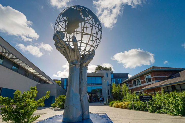 The 'In our hands' sculpture by Simon Ruscoe outside the Business School