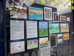 a window displays art work from veterans made throughout this project