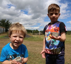 Dennis Hewings' great grandsons with their new pots
