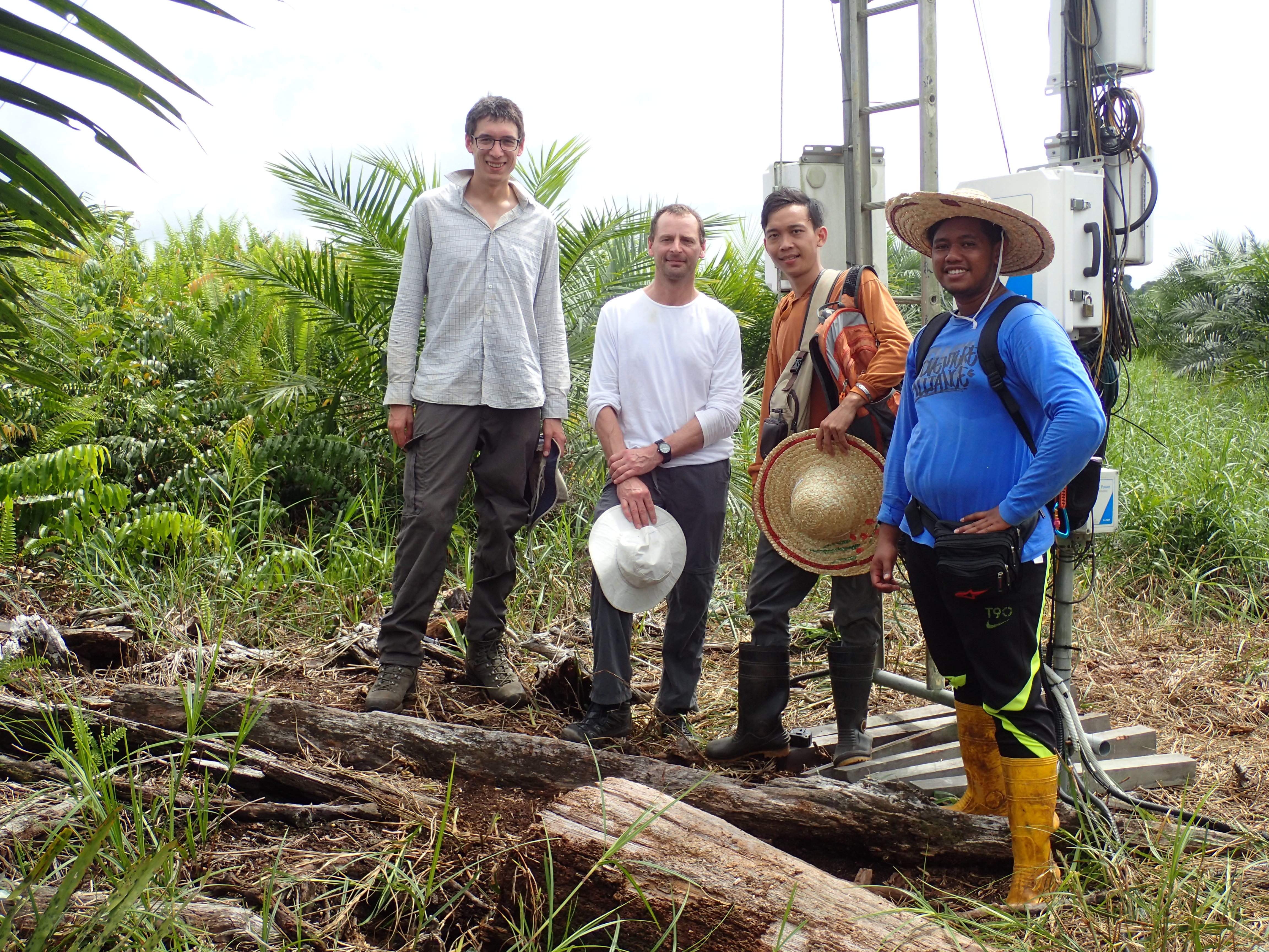Tim Hill, Jon McCalmont, Ham and Jai at the recently converted oil palm site